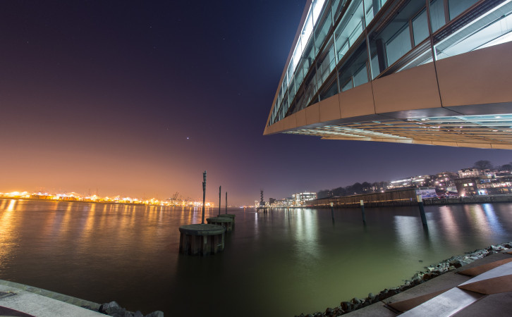 Dockland at night, watching over the Elbe river.